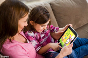 Toddler and parent reading Cutest Book Ever on iPad