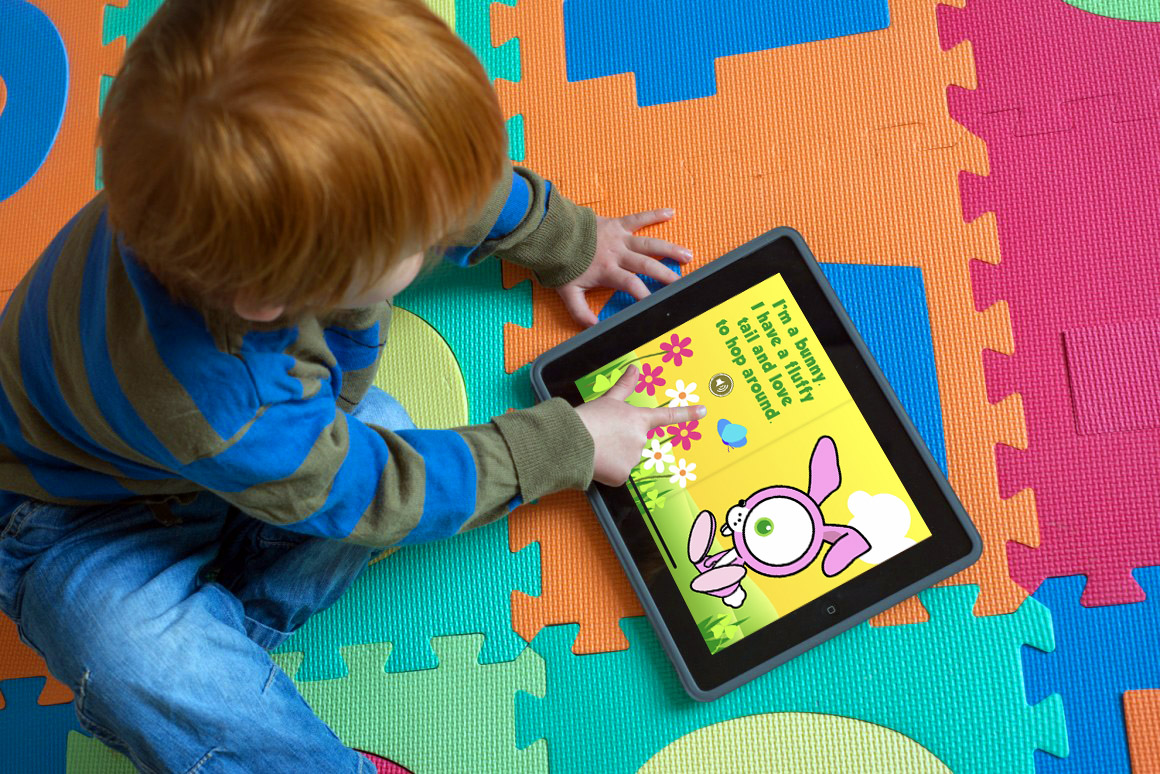 Toddler interacting with Cutest Book Ever on iPad.psd